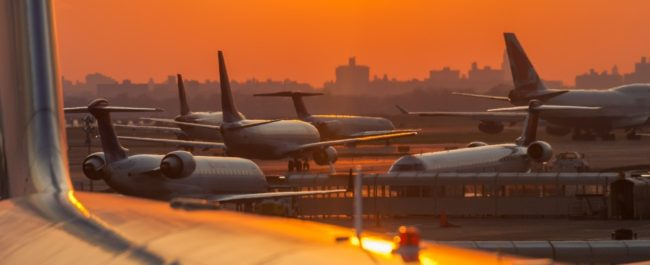 Sunset at the airport with airplanes ready to take off