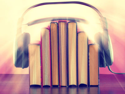 headphones over books symbolising audiobook recordings